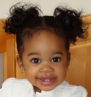 beautiful_black_baby_girl_with_her_pretty_hairstyle_with_a_sweet_smile